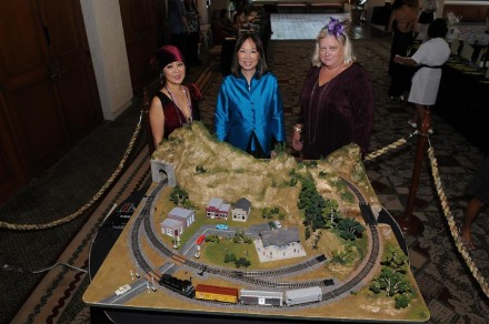 HWLF Board Members Joy Miyasaki, Karen Char and Rosemary McShane (with the train set they built and auctioned)